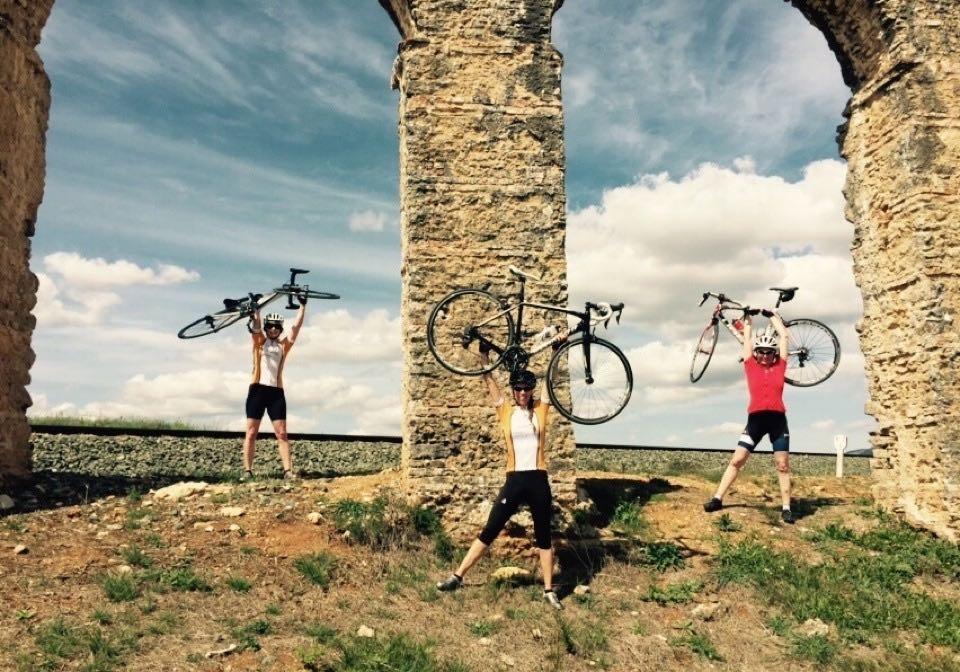 Girls holding up bikes in Ronda
