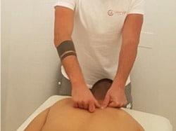 Massage therapist treating trigger points